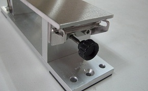 This wedge roller is a fixed side. When this screw is turned, the wedge roller on the other side pulls the sandpaper.