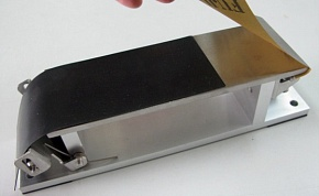 The rubber board of the attachment is used to grind the convex surface of the knife. The rubber board is inserted between the sandpaper and apparatus.