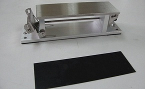 COMP2 is composed of apparatus and a rubber board. So as not to rust, apparatus is made of the stainless steel and the aluminum board.